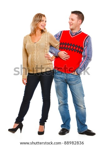 Full length portrait of happy beautiful pregnant woman with husband on white background - stock photo