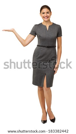 Full length portrait of happy businesswoman presenting invisible product isolated over white background. Vertical shot. - stock photo