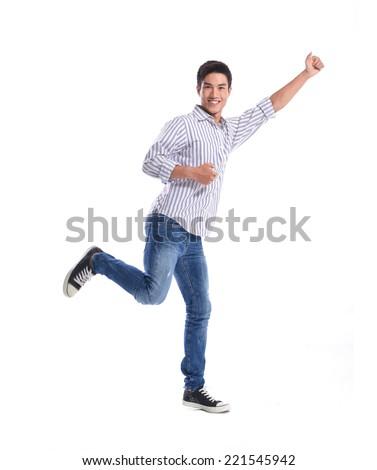 Full length Portrait of happy casual man  walking in studio - stock photo