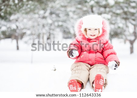 Full length portrait of happy child in winter park