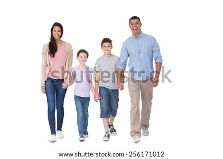 Full length portrait of happy family walking over white background - stock photo