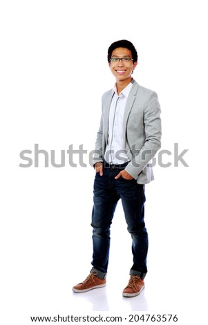 Full length portrait of happy fashion asian man isolated on a white background - stock photo