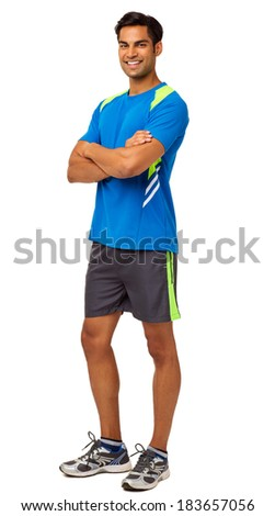 Full length portrait of happy fit man standing arms crossed over white background. Vertical shot. - stock photo