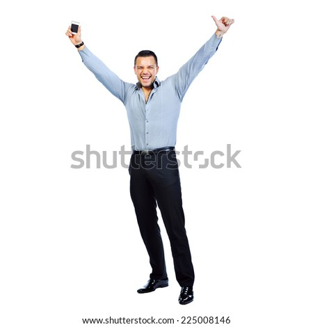 Full length portrait of happy gesturing young smiling business man with mobile phone, isolated over white background - stock photo