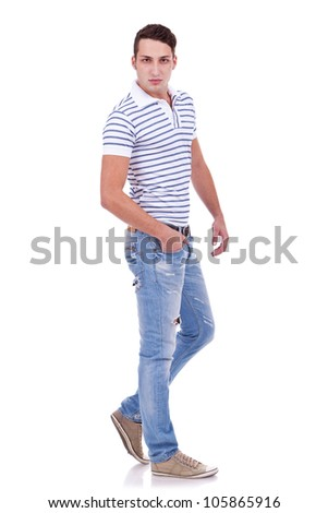 Full length portrait of happy handsome young casual man isolated on white background - stock photo