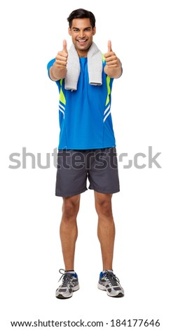 Full length portrait of happy man in sports clothing gesturing thumbs up over white background. Vertical shot. - stock photo