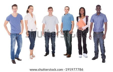 Full length portrait of happy multiethnic fashion models and student standing against white background - stock photo