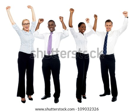 Full length portrait of happy successful business group over white background