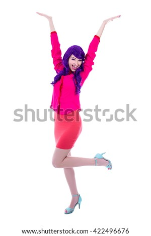 full length portrait of happy woman in pink with purple hair isolated on white background