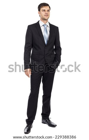Full length portrait of happy young business man with hand in his pocket over white background