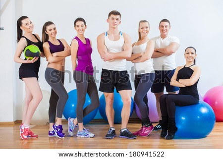 Full length portrait of instructor with fitness class