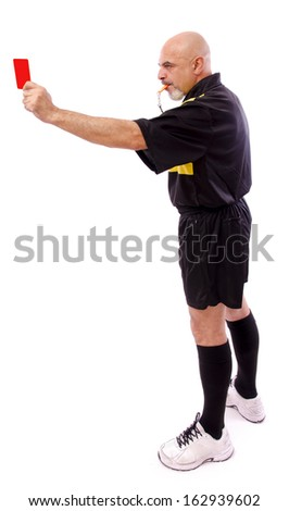 Full length portrait of isolated soccer referee, red card. - stock photo