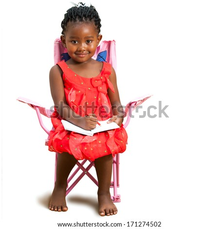 Full length portrait of little african girl sitting with note book.Isolated on white background. - stock photo