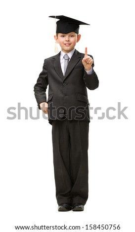 Full-length portrait of little student attention gesturing, isolated on white. Concept of study and graduation
