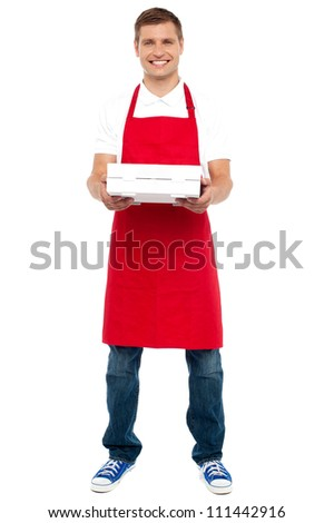 Full length portrait of male chef holding pie box isolated against white background