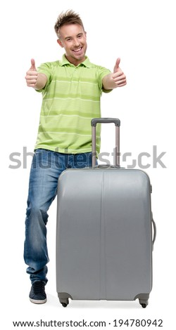 Full-length portrait of man with silver suitcase thumbs up, isolated on white. Concept of traveling and cool vacations - stock photo
