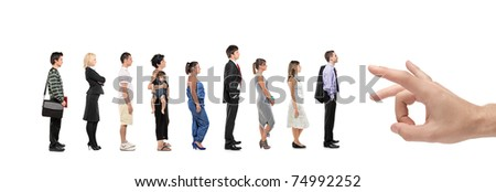 Full length portrait of men and women standing in a line with a hand about to push them isolated on white background