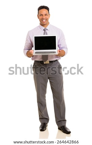 full length portrait of middle aged businessman presenting laptop - stock photo