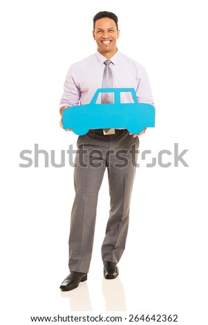 full length portrait of middle aged man holding blue paper car - stock photo