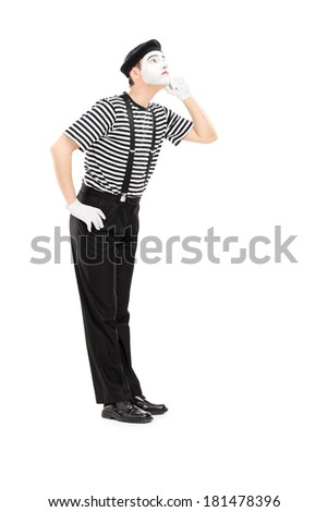 Full length portrait of mime artist listening something isolated on white background - stock photo
