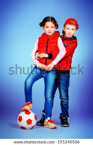 Full length portrait of modern boy and girl standing together. Active lifestyle. Fashion.  - stock photo