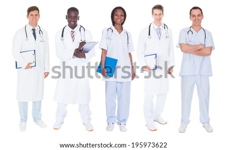 Full length portrait of multiethnic doctors standing over white background - stock photo