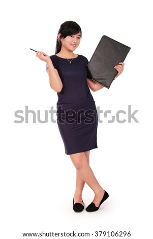 Full length portrait of playful business woman posing with big book and pen, isolated on white background - stock photo