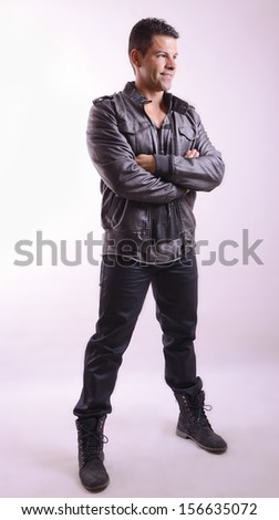 Full length portrait of posing man with leather jacket - stock photo