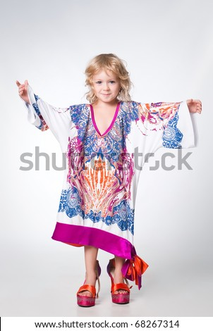 full length  portrait of pretty girl trying mama's outfit - stock photo