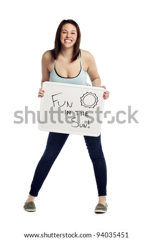 Full length portrait of pretty young female holding sign board - stock photo