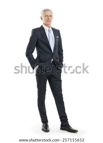 Full length portrait of senior businessman standing against white background. - stock photo