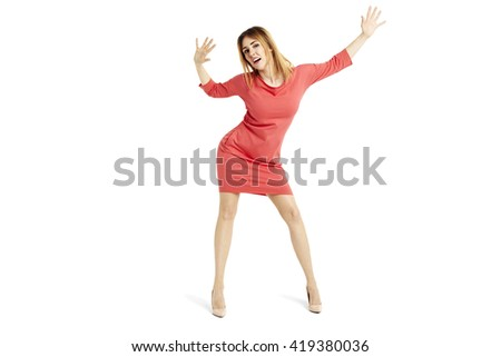 Full length portrait of sensual woman in a red dress. She is dancing. - stock photo