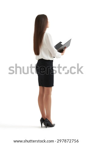 full-length portrait of serious businesswoman in formal wear holding open folder and looking forward. isolated on white background - stock photo