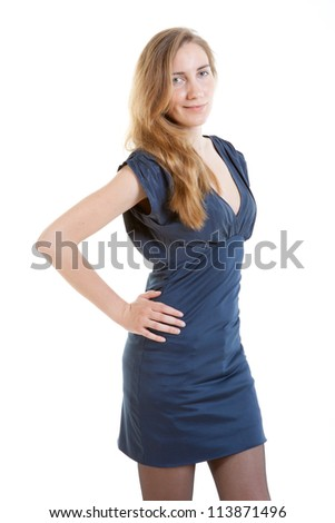 Full-length portrait of sexy young woman in a blue dress