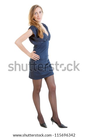 Full-length portrait of sexy young woman in a blue dress - stock photo