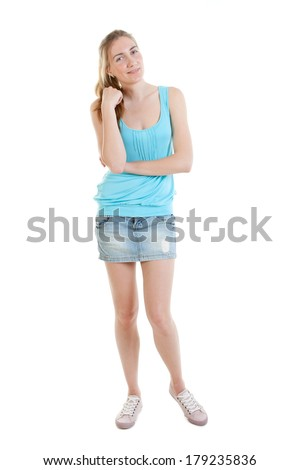 Full-length portrait of sexy young woman wearing jans mini-skirt, blue t-shirt and gumshoes - stock photo