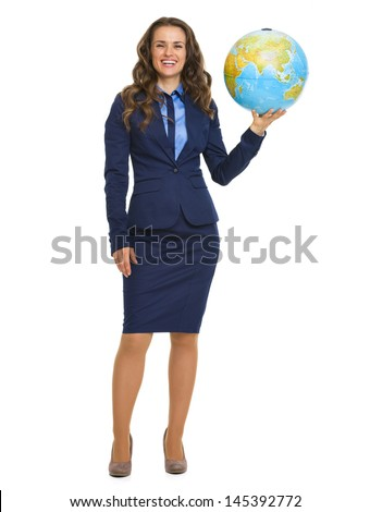 Full length portrait of smiling business woman holding earth globe