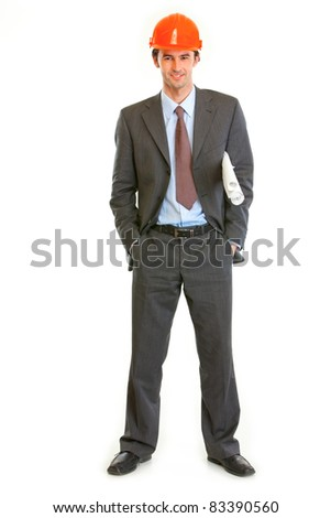 Full length portrait of smiling businessman in helmet holding building plans in hand isolated on white - stock photo