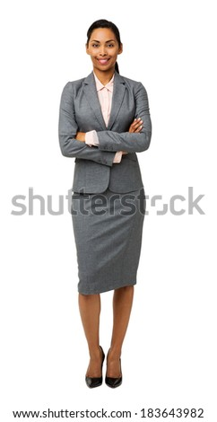 Full length portrait of smiling businesswoman standing arms crossed against white background. Vertical shot.