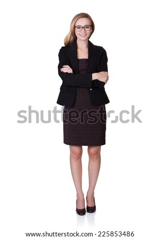 Full length portrait of smiling businesswoman standing arms crossed over white background