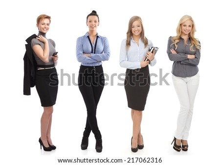 Full-length portrait of smiling businesswomen, cutout on white background. - stock photo