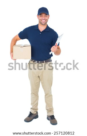 Full length portrait of smiling delivery man with package and clipboard on white background - stock photo