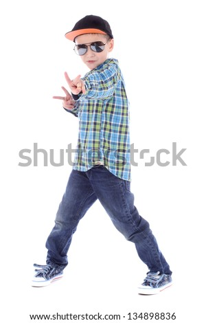 Full length portrait of smiling little boy in jeans cup and sunglasses on white background - stock photo