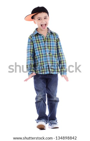 Full length portrait of smiling little boy showing tongue on white background - stock photo