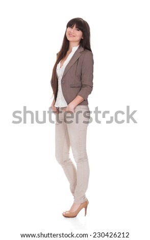 Full length portrait of smiling young businesswoman isolated over white background - stock photo