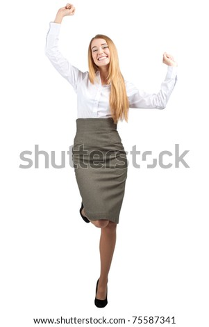 Full length portrait of successful young businesswoman raising her arms in joy and dancing. Isolated on white background