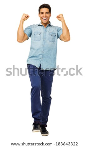 Full length portrait of successful young man celebrating success over white background. Vertical shot. - stock photo