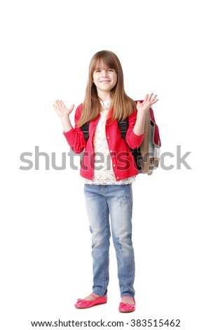 Full length portrait of surprised preschool girl with backpack looking at camera and smiling while standing against white background. - stock photo