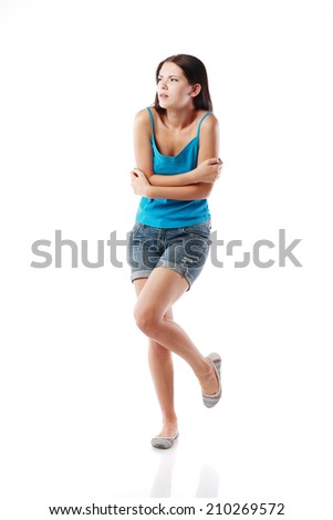 full-length portrait of trembling woman, isolated on white. Concept of cold and chill  - stock photo