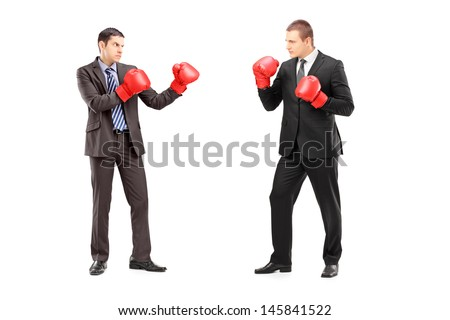 Full length portrait of two businessmen having a fight with boxing gloves, isolated on white background - stock photo